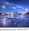 Milky Way above frozen sea coast, snowy mountains 43427677