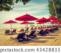 Umbrella and chair on the tropical beach sea and ocean 43428833