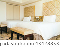 White comfortable pillow on bed decoration in hotel bedroom 43428853