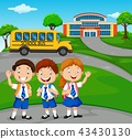Happy school children in front of the school 43430130