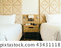 White comfortable pillow on bed decoration in hotel bedroom 43431118