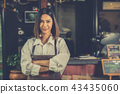 Woman barista successful small business owner. 43435060