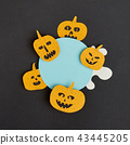 Creative Halloween handmade blue frame with paper horrible smiling and laughing pumpkins on a black 43445205