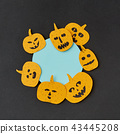 Decorative round blue Halloween frame handcraft with paper laughing pumpkin on a black paper 43445208