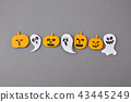 Halloween pattern from handmade paper scary ghosts and spirits, yellow pumpkins on a gray paper. 43445249