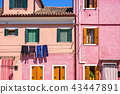 Daylight view to vibrant pink house front facade 43447891