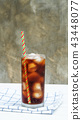 Iced aerated soft drink on a white wooden table. 43448077