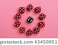 Red and black gaming dices on pink background 43450051