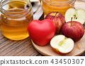 Apple cider vinegar on wooden board, Kombucha. 43450307