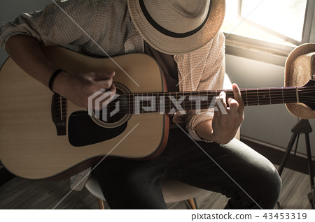 musician playing the guitar 43453319