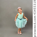 Full length of little fashion girl in studio 43455319