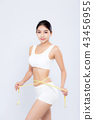 beautiful asian woman diet with measuring waist 43456955