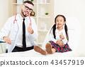 Doctor examining little happy kid in hospital. 43457919