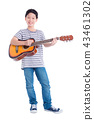 boy playing guitar and smiles over white  43461302