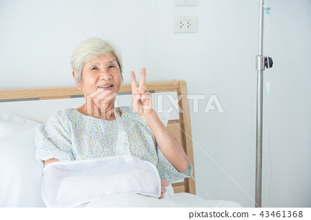 Senior female patient smiling on bed at hospital 43461368