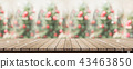 wood plank table top with blur christmas tree 43463850