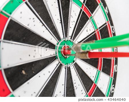 Close Up of Dart Holes on Dart Board 43464040