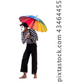 Mime with umbrella isolated on white background 43464455