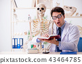 Crazy professor studying human skeleton 43464785