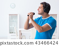 Young handsome man singing karaoke at home  43466424