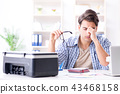 Young man employee working at copying machine in the office  43468158