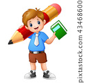 School boy holding a book with giant pencil 43468600