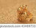 gold rose flower ring on glitter background 43469733
