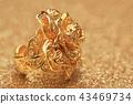 gold rose flower ring on glitter background 43469734