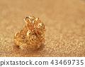 gold rose flower ring on glitter background 43469735