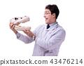 Funny crazy professor paleontologyst studying animal skeletons i 43476214