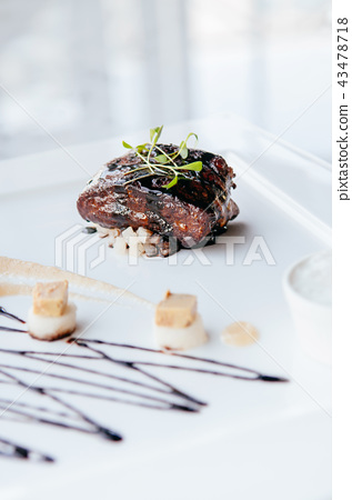 Fried Foie gras with sweet and sour balsamic sauce 43478718