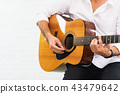 man playing guitar on white background 43479642