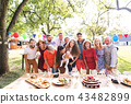Family celebration or a garden party outside in the backyard. 43482899