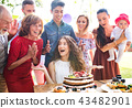 Family celebration or a garden party outside in the backyard. 43482901