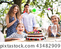 Family celebration or a garden party outside in the backyard. 43482909