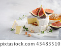 Brie or camembert cheese with figs, thyme, honey. 43483510