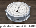 Barometer closeup on the wooden background 43484409