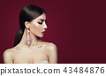 Young woman with fashion jewelry earrings 43484876