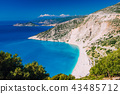 Beautiful view of Myrtos beach in high tourist summer season. Myrtos is one of the famous beaches in 43485712