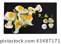 Fried quail eggs with champignons 43487171