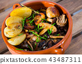 Delicious different mushrooms cooked with potatoes at clay pot 43487311