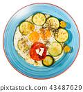 Scrambled eggs with zucchini, close-up 43487629