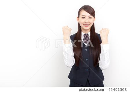 정장 차림의 젊은 여성 승리의 포즈 43491368
