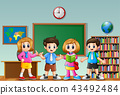 Many children standing in the front of classroom 43492484