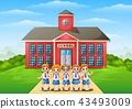 Happy school children in front of school building 43493009