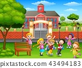 Happy school children playing in front of school 43494183