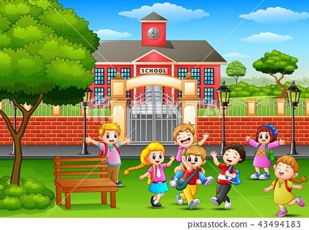 Happy school children playing in front of school 43494183