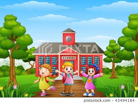 Happy school children standing in front of school  43494184