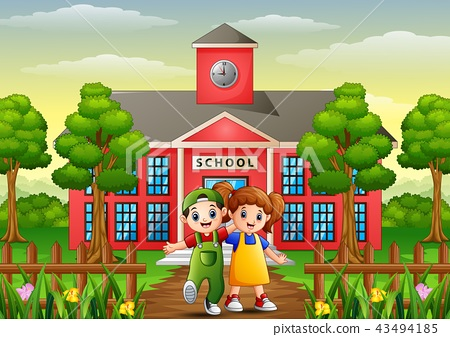 Happy school children standing in front of school  43494185