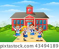 Happy school children in front of school building 43494189